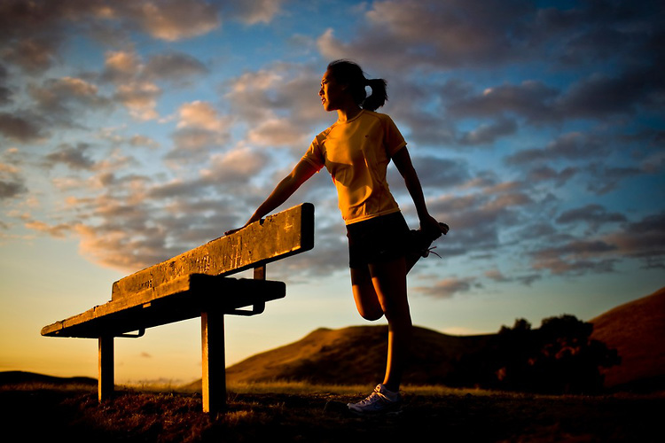 woman-stretching-runner-female-asian-landscape-sunset-yellow